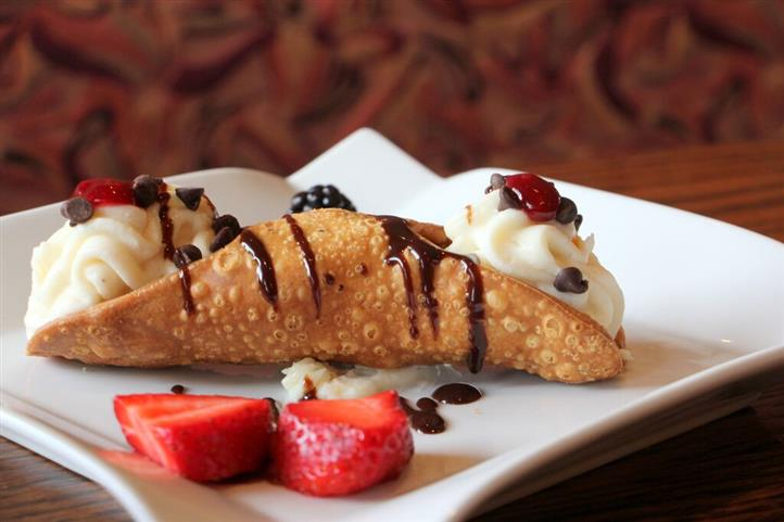 Cannoli with a strawberry side