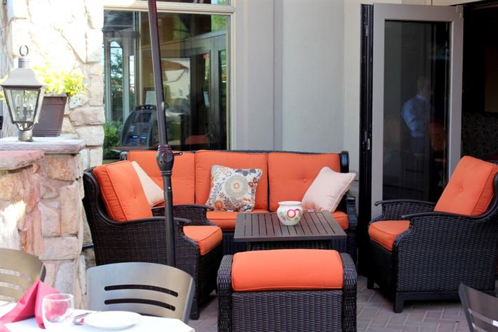 Patio area with sofas and throw pillows