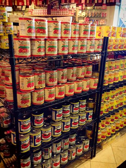 Interior shot of Primavera Italian Specialties with cans of tomato sauces