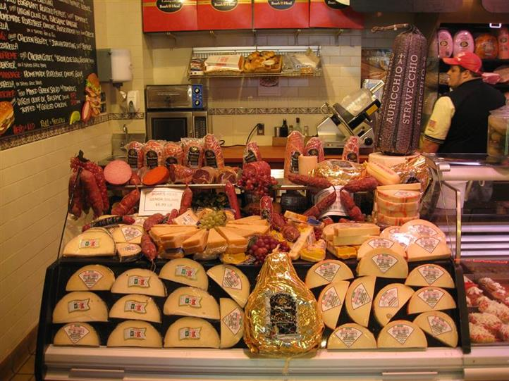 Interior shot of Primavera Italian Specialties with several cold cuts and cheeses