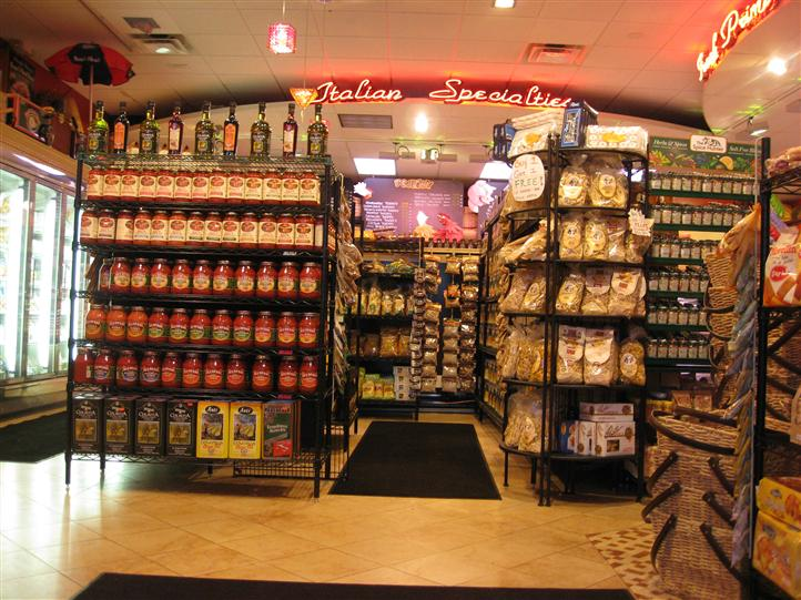 Interior shot of Primavera Italian Specialties with stands with several items