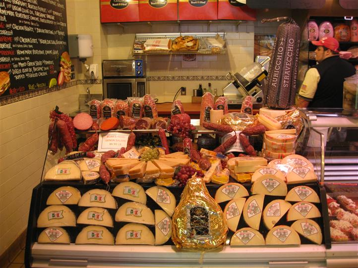 Interior shot of Primavera Italian Specialties. Fridge with Italian cheese and meat