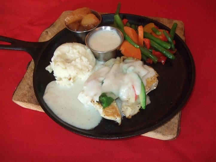 menu item with mashed potatoes and vegetables on the side