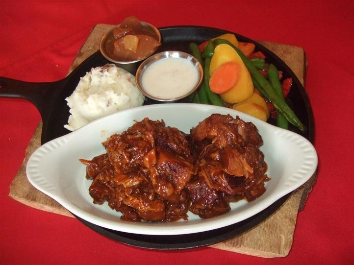menu item with mashed potaotes and vegetables on the side