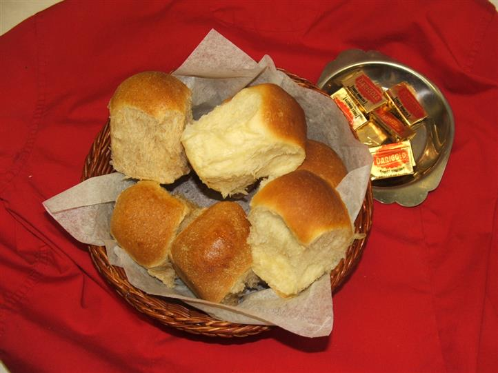 bread in a basket with butter on the side