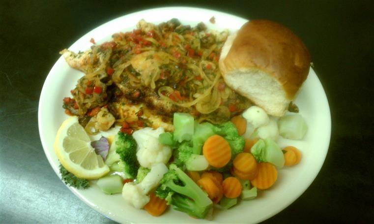 Broiled Stuffed Catfish with vegetables and buttered roll