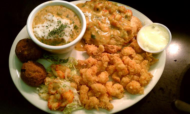 Crawfish Platter with popcorn shrimp, fish and dipping sauce