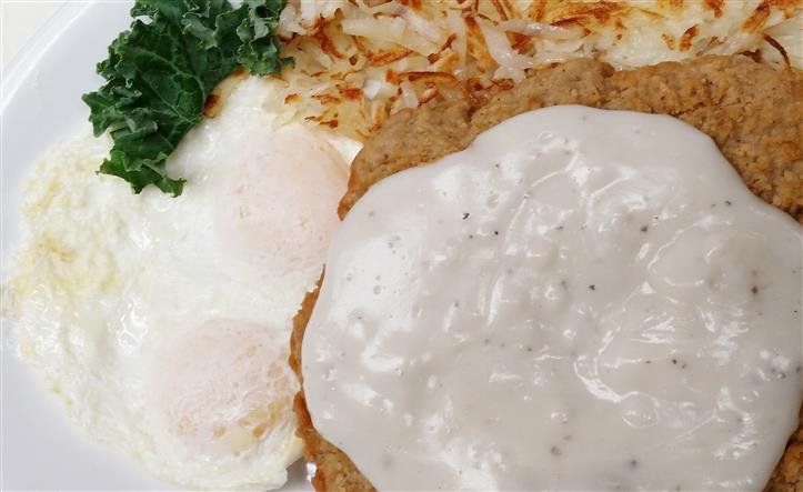Country fried steak with hash browns, eggs, gravy