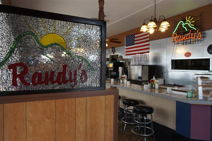 Randy's logo with kitchen area in the background and American flag