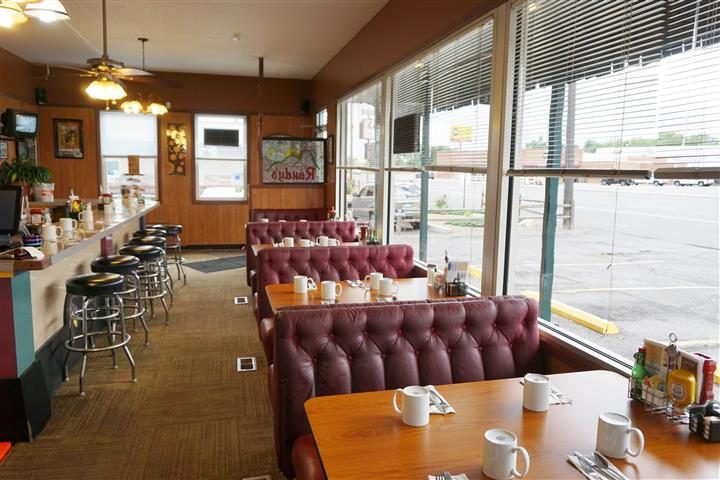 Dining area of diner with windows to the side of the establishment