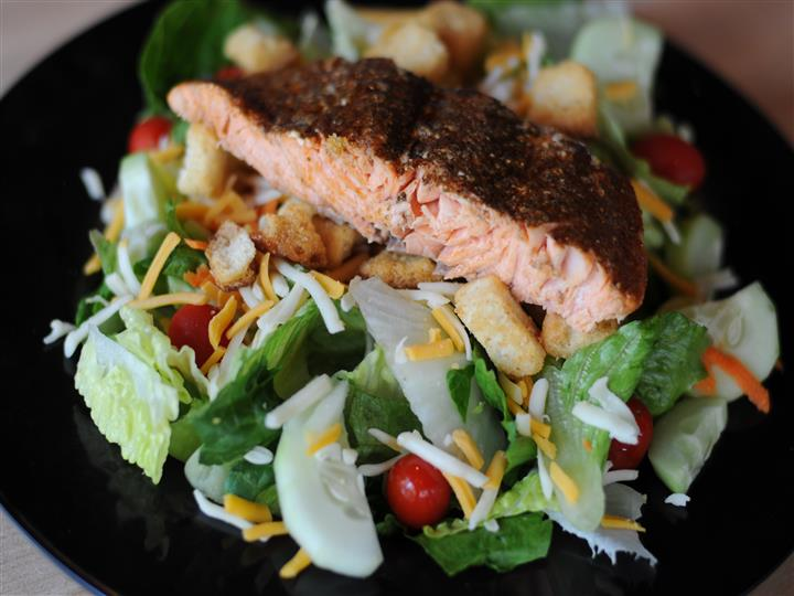 mixed salad with salmon filet