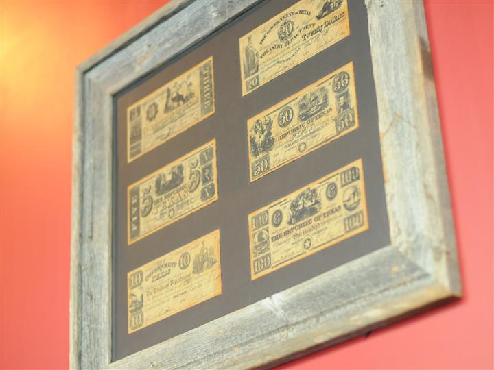 plaque with antique-style bank notes