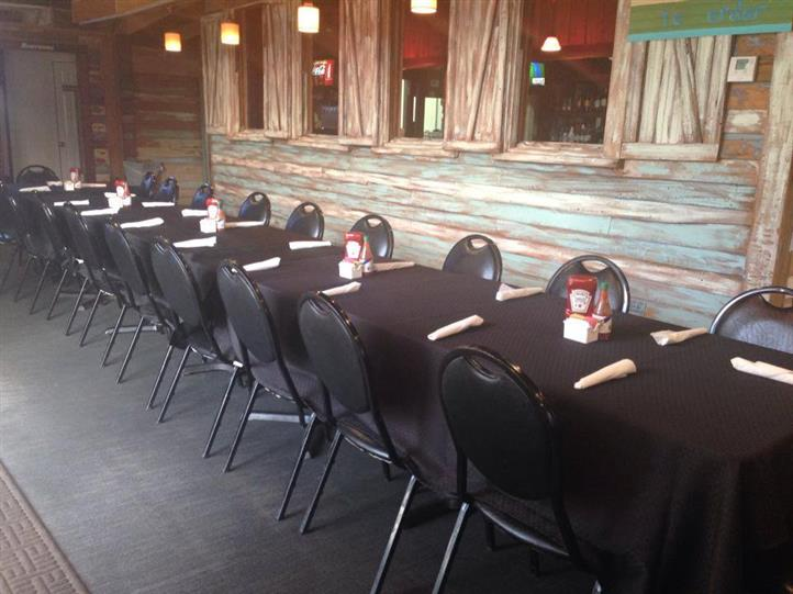 long table with chairs and table cloth