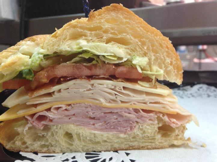 turkey and ham sandwich with cheese, lettuce and tomato