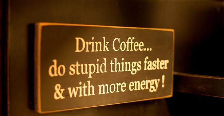 sign that says drink coffee... do stupid things faster & with more energy!