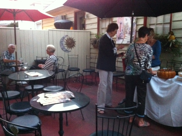 customers standing outside on the patio