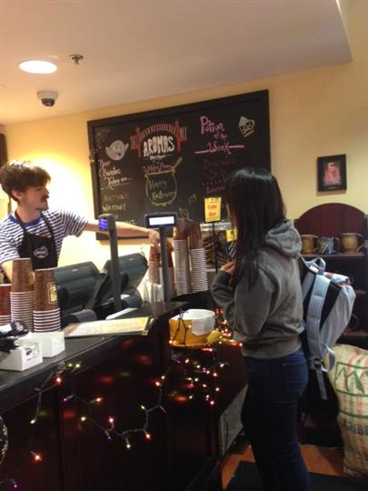 customers placing order with worker behind the counter