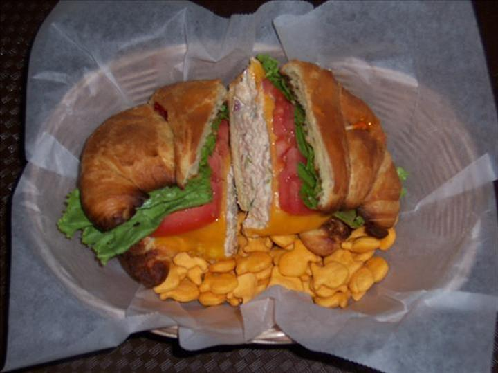 chicken salad on a croissant with goldfish crackers
