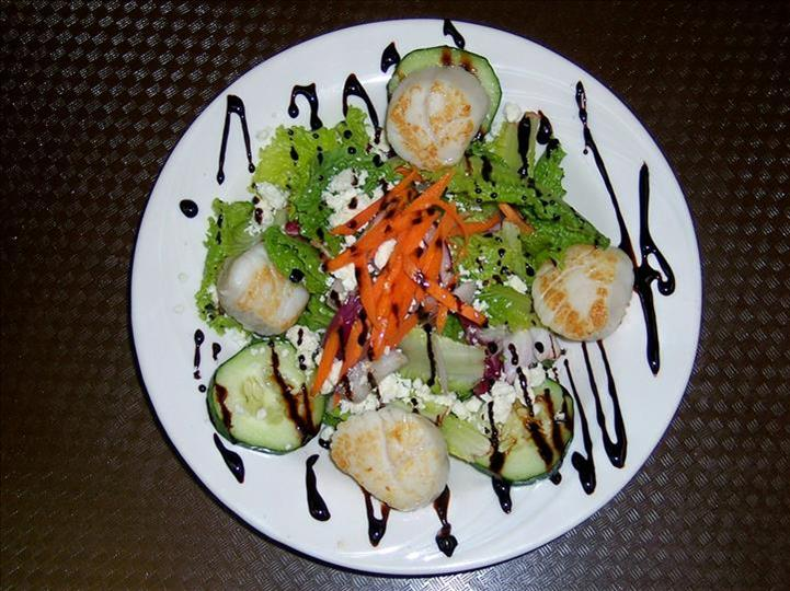 salad drizzled with dressing on a plate