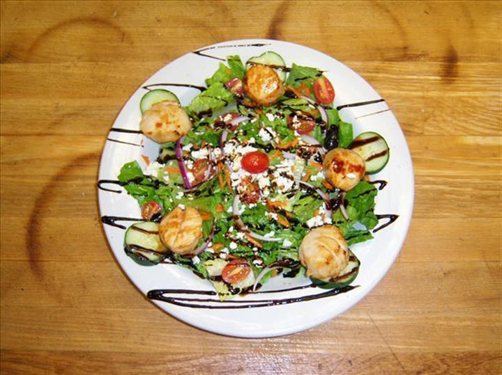 house salad topped with shrimp