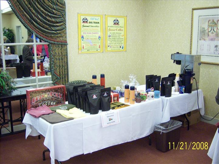 table set up with coffee machines and a variety of coffee flavors