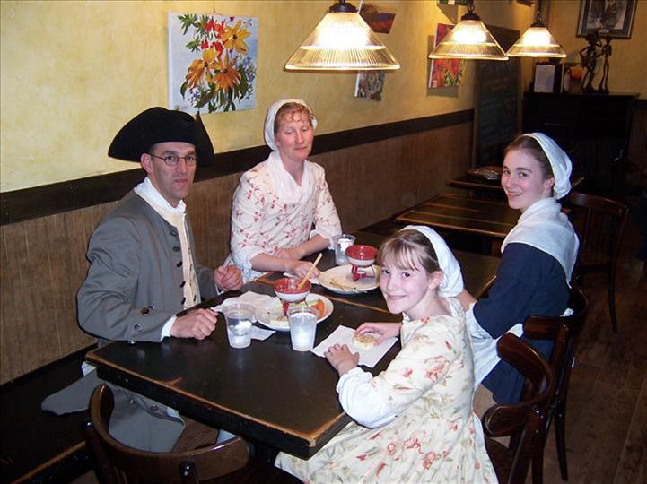 family of four sitting at table