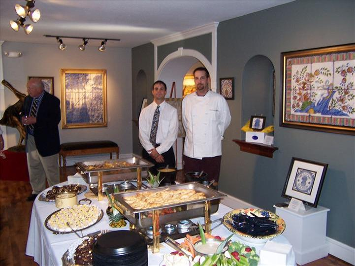 two men standing behind buffet table