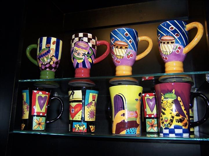 several different painted coffee mugs