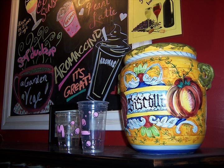 a big jar with a menu on a chalkboard