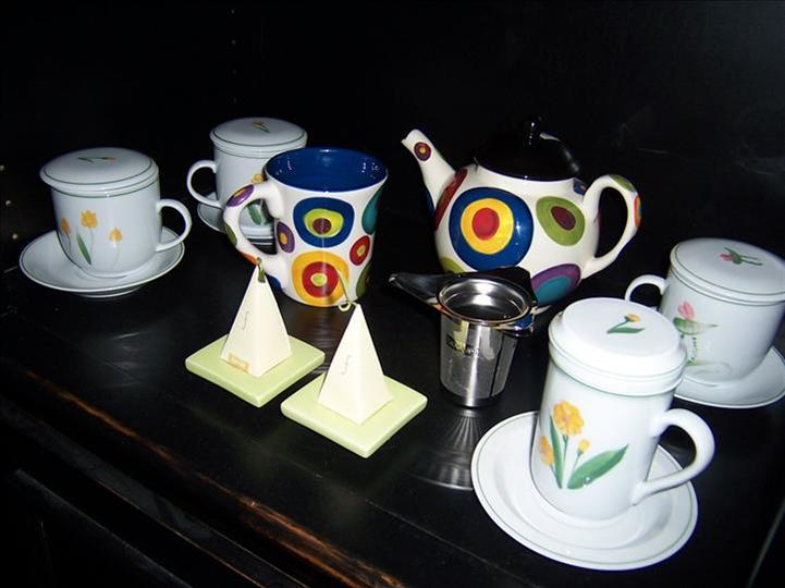 a variety of coffee cups on a table