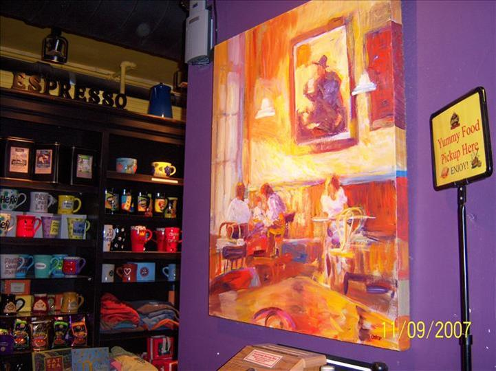 inside aromas with a painting on the wall