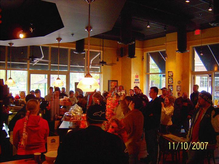 inside view of aromas with people standing