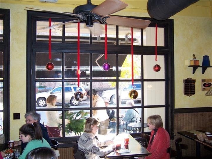inside view of aromas with people sitting at tables