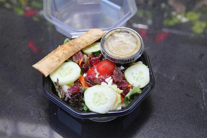 salad in container with dressing