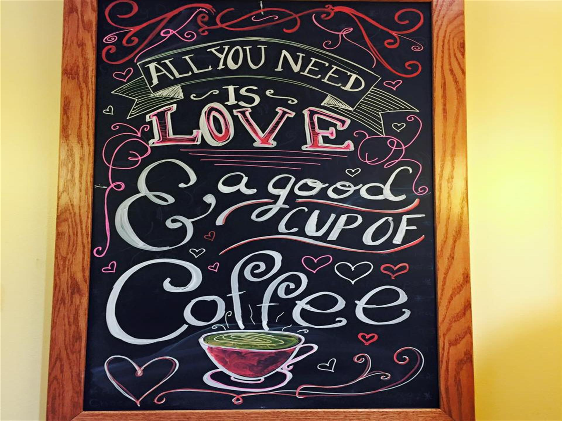 black chalkboard that reads all you need is love & a good cup of coffee