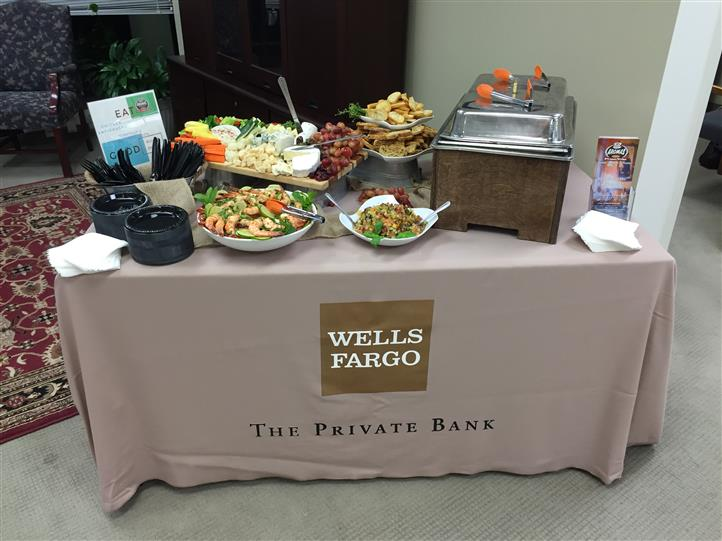 a buffet table with wells fargo logo