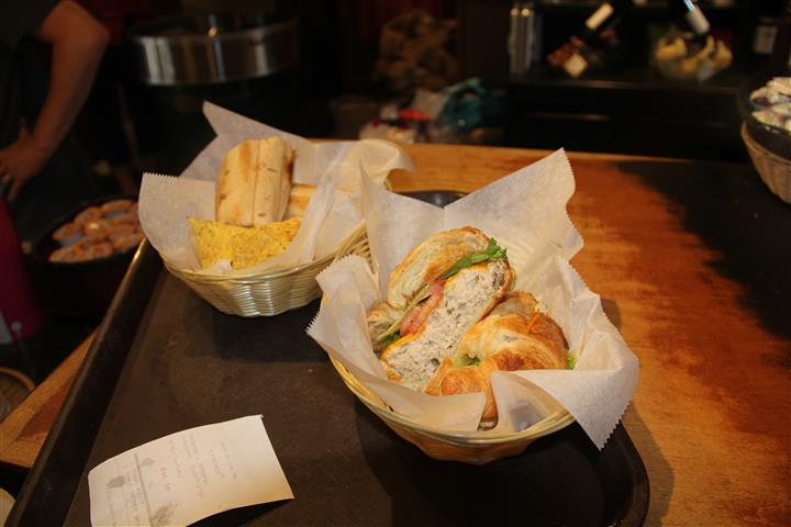 two baskets with sandwiches cut in half