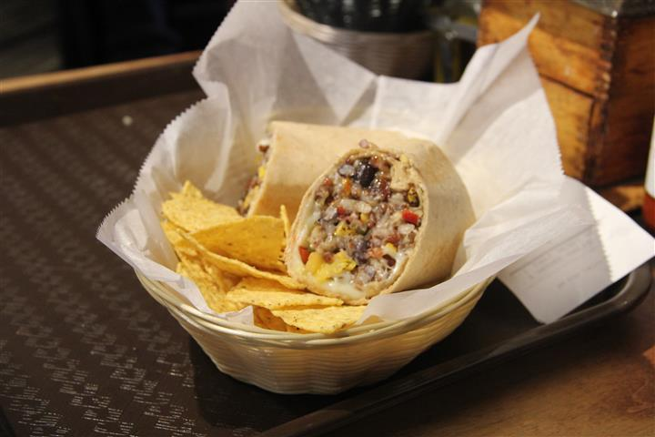 burrito wrap sliced in half with tortilla chips