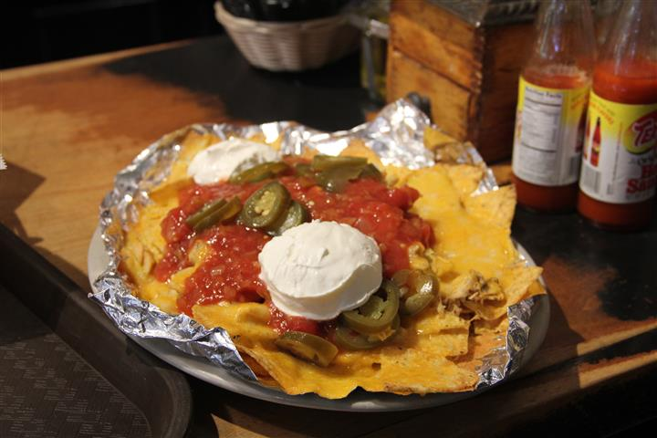 tortilla chips topped with sauce and sour cream