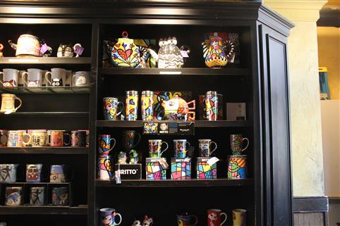 wall with a variety of coffee mugs