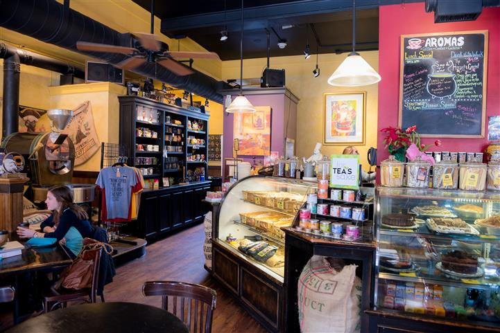 inside of aromas with view of counter