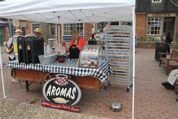 table set up outside with the aromas logo under it