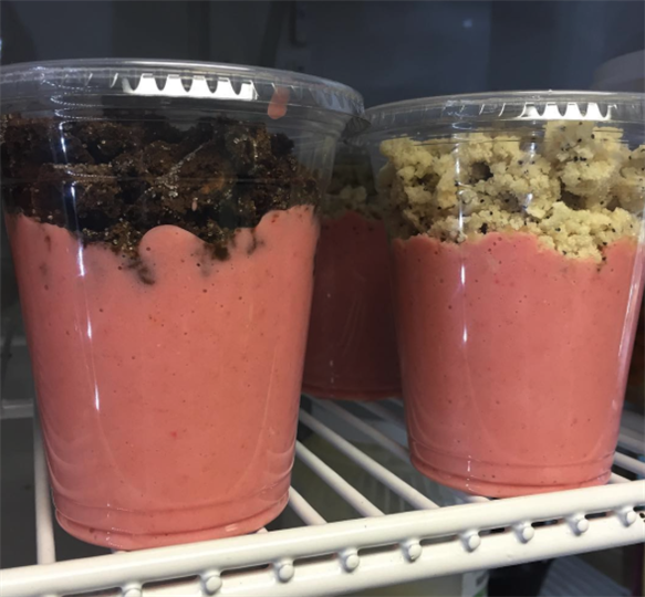 yogurt in a cup topped with granola