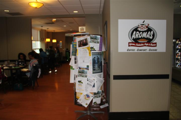 inside view with the aromas logo on the wall