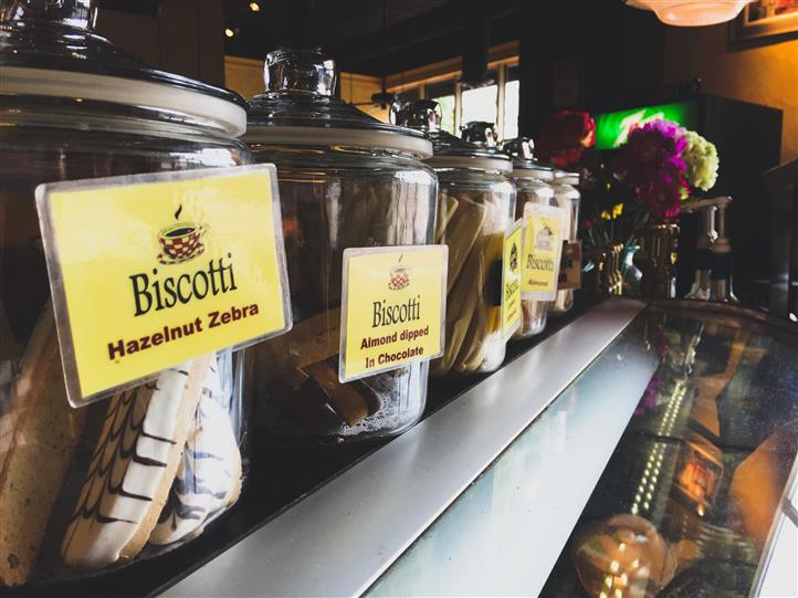 glass jars filled with a variety of biscotti