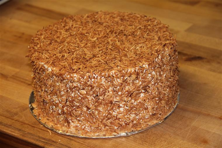 Coconut Cake with coconut flavored buttercream and covered in toasted coconut.