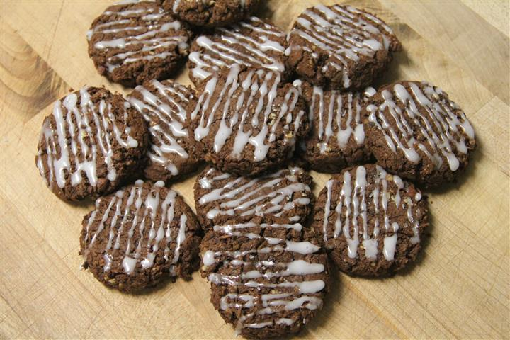 Chocolate cookies with pecans, coconut, chocolate chunks, royal iceing and sprinkled with sea salt.
