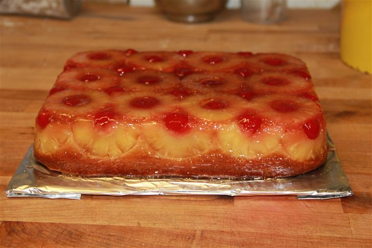 Pineapple slices with a maraschino cherry in the center dressing up this classic cake.