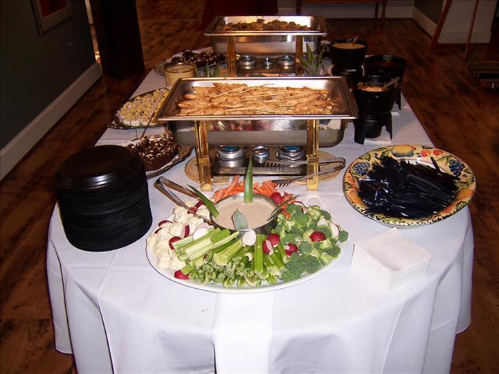 buffet table with vegetables and dipping sauce