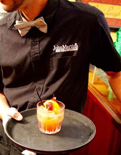 Cocktail being served by a staff member